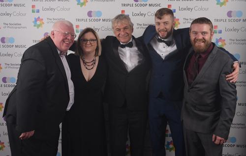 Phil Jones, Terrie Jones, Colin and Ben Jones from The Societies' with Andy Lauder.