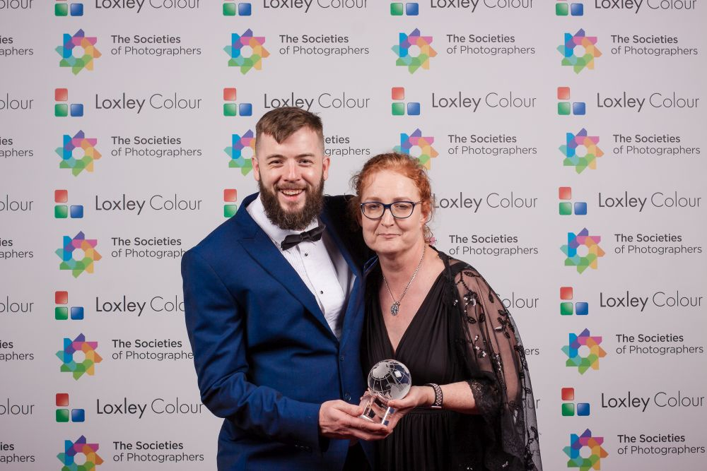 Colin Jones presents Jocelyn Conway with the award.