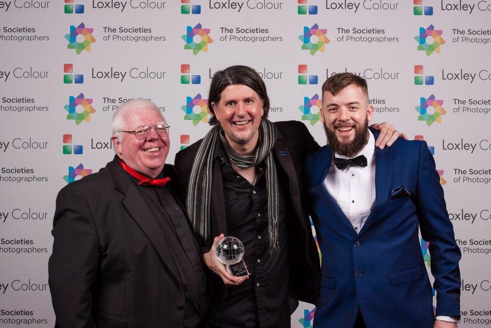 Phil Jones and Colin Jones present Luke Edmonson with the award.