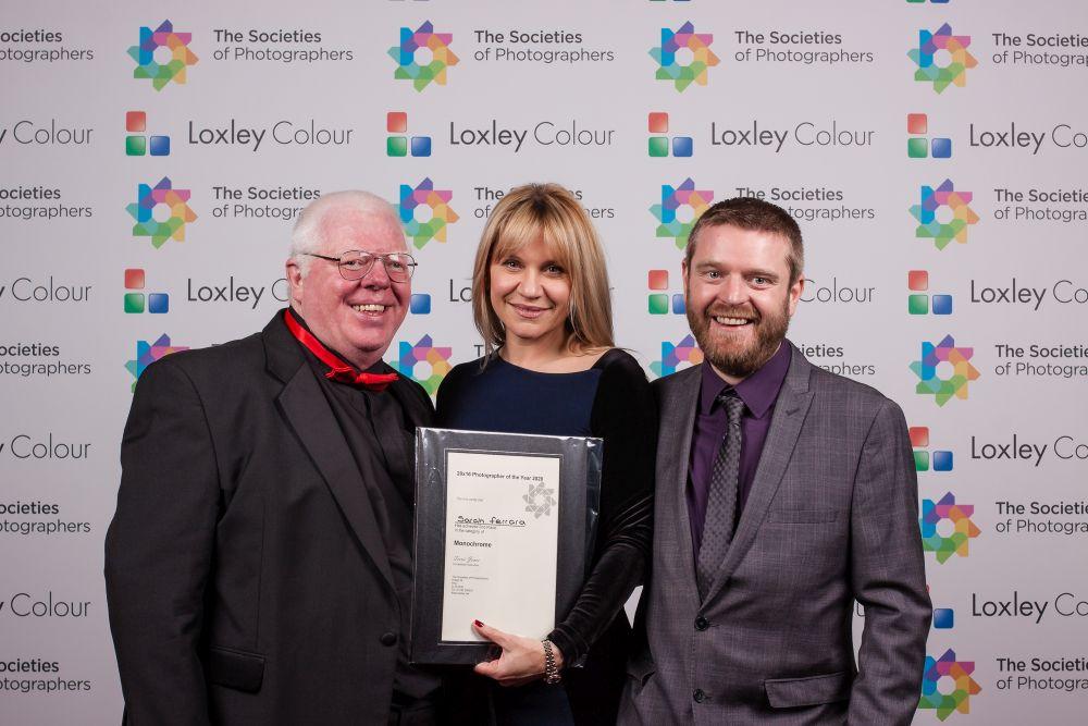 Phil Jones and Ben Jones present Sarah Ferrara with the award.