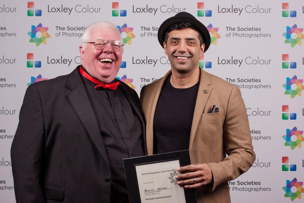 Phil Jones presents  Gurvir Johal with the award.