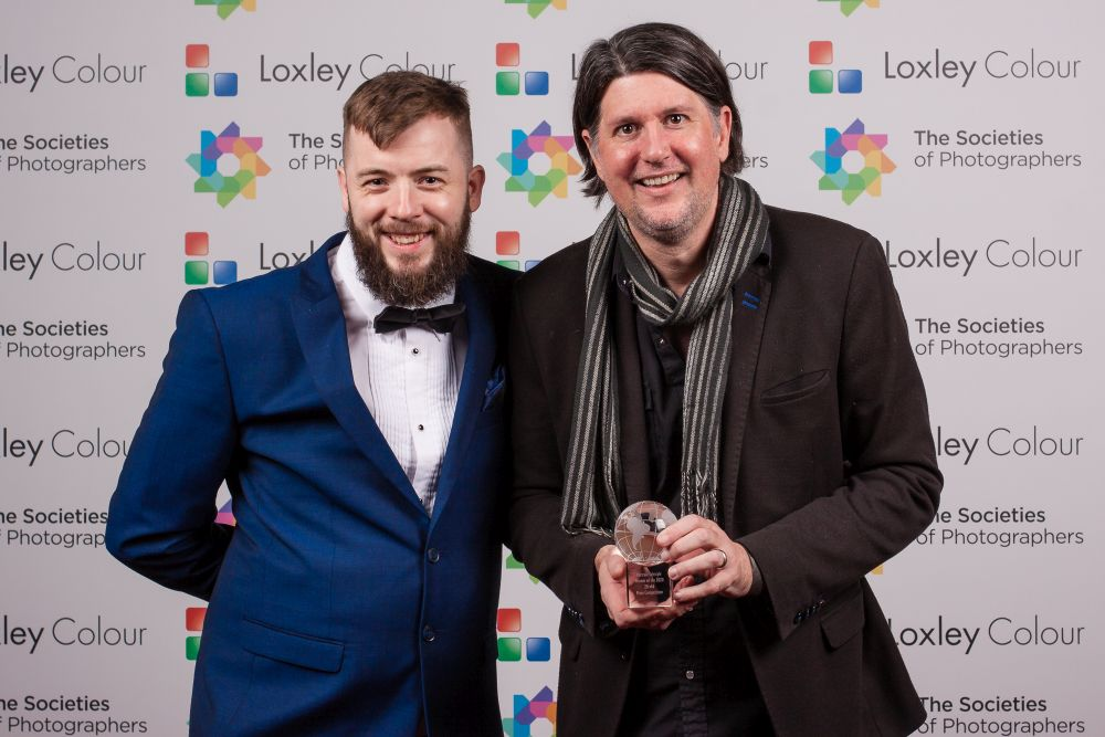 Colin Jones presents Luke Edmonson with the award.