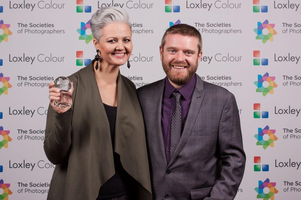 Ben Jones presents Kelly Brown with the award.