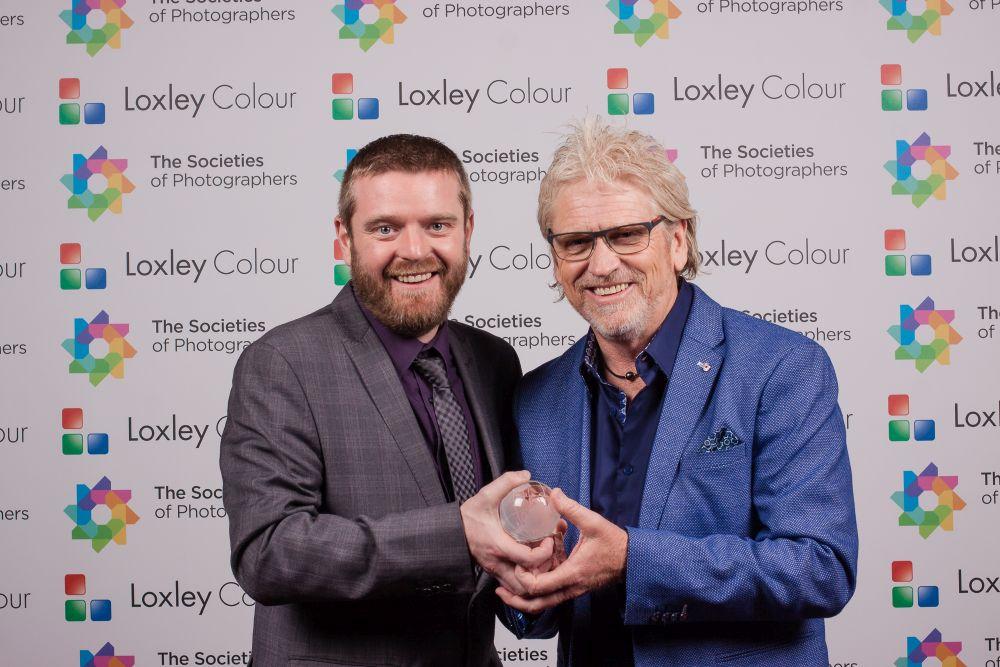 Ben Jones presenting Tony Hewitt with the award.