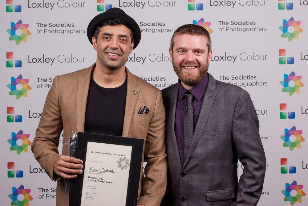 Ben Jones presents Gurvir Johal with the award.