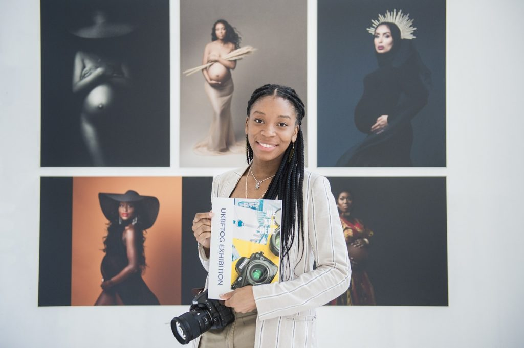 Grimmy West Photography Tianna J Williams in front of her exhibit